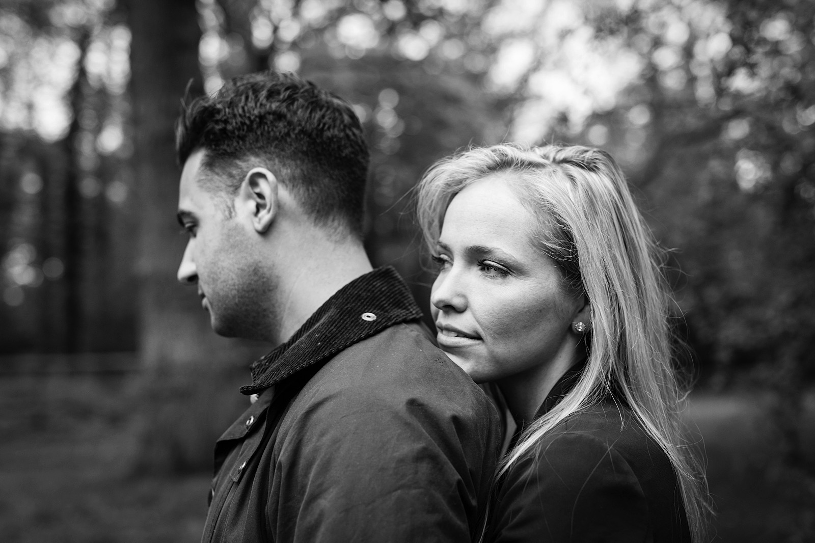 Black and white couples portrait in a forest in England