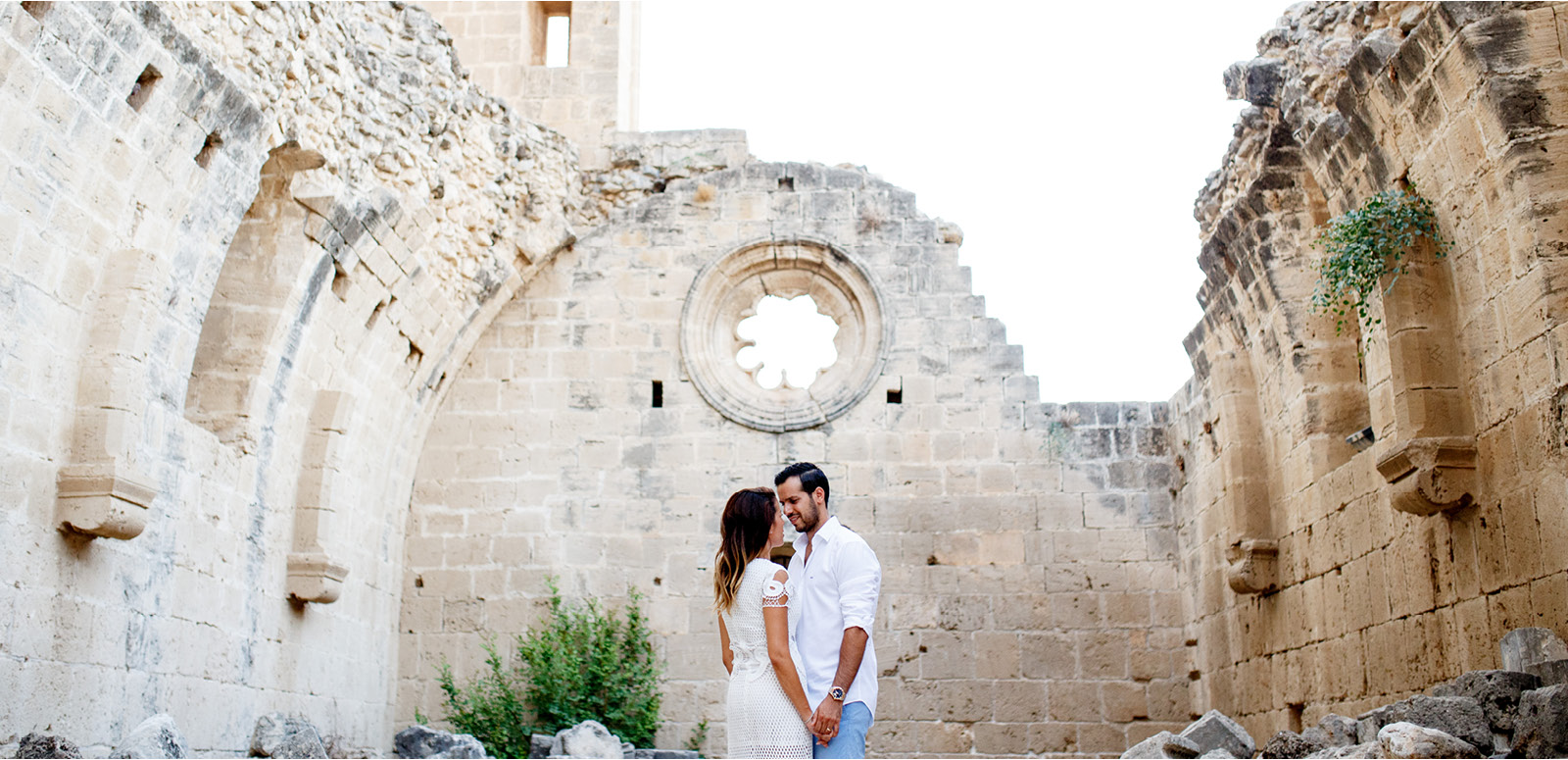 Bride and Groom looking at each other during wedding portraits in Bellapais Abbey in North Cyprus