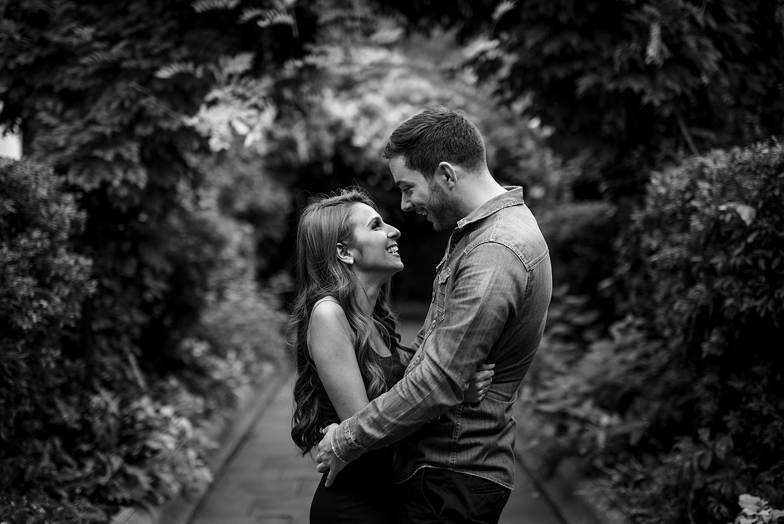 Black and White Photo of a Couple looking at each other during their couple shoot