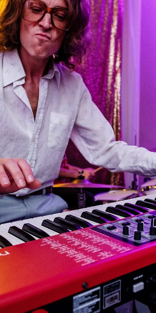 Keyboard player as part of a wedding band performing at a reception