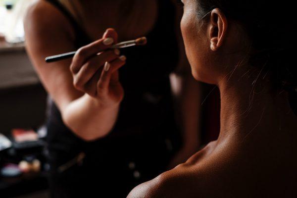 Make up Artist applying makeup to bride