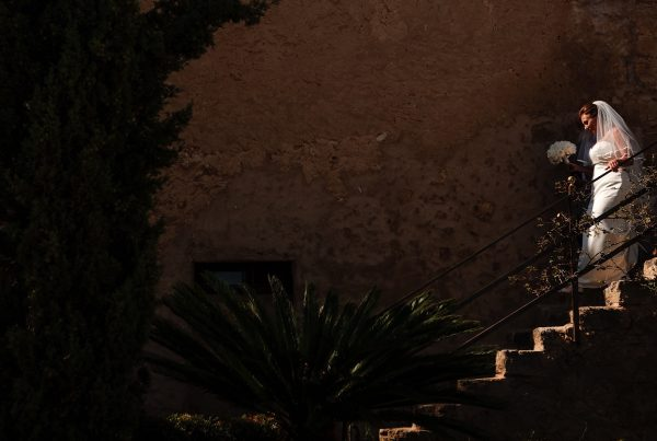 Bride descending stone steps at Finca Son Mir on her way to her ceremony