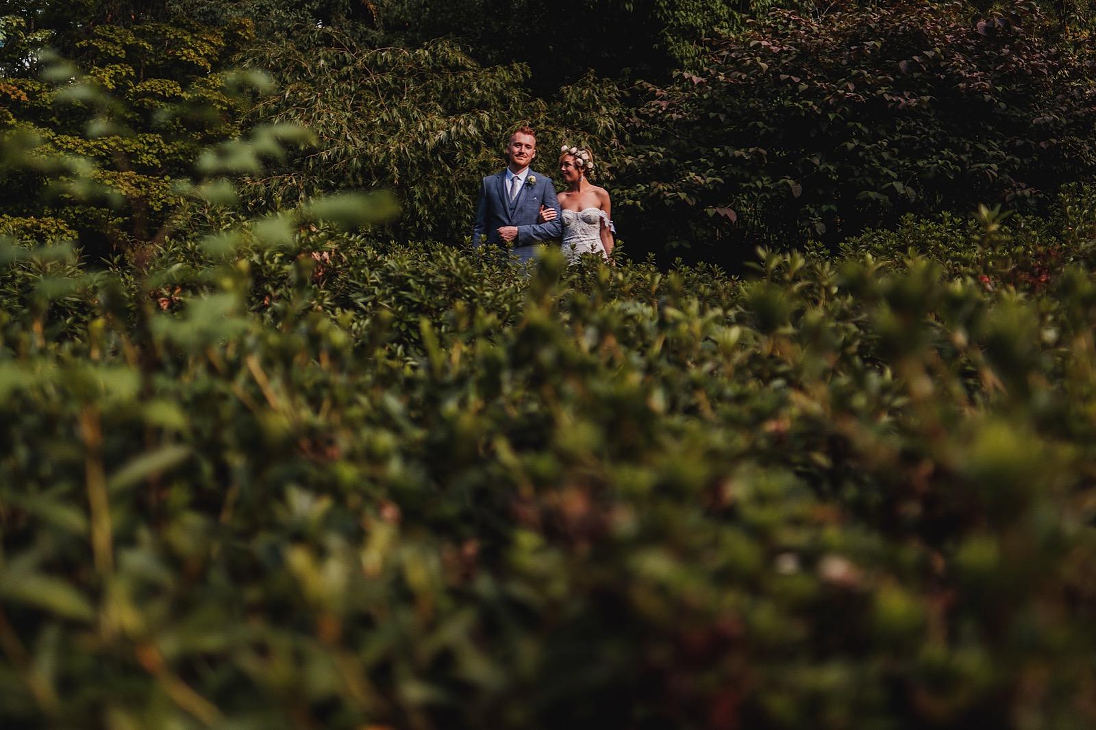 Bride & Groom captured amongst greenery