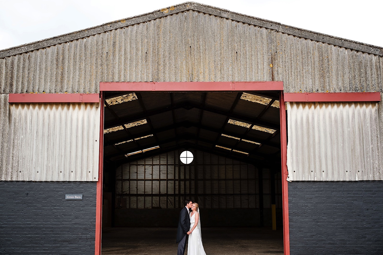 Bride and Groom celebrating a Barn Wedding in Hertfordshire