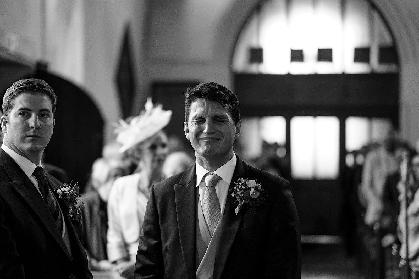 Emotional Groom at a wedding waiting for the bride to walk down the aisle