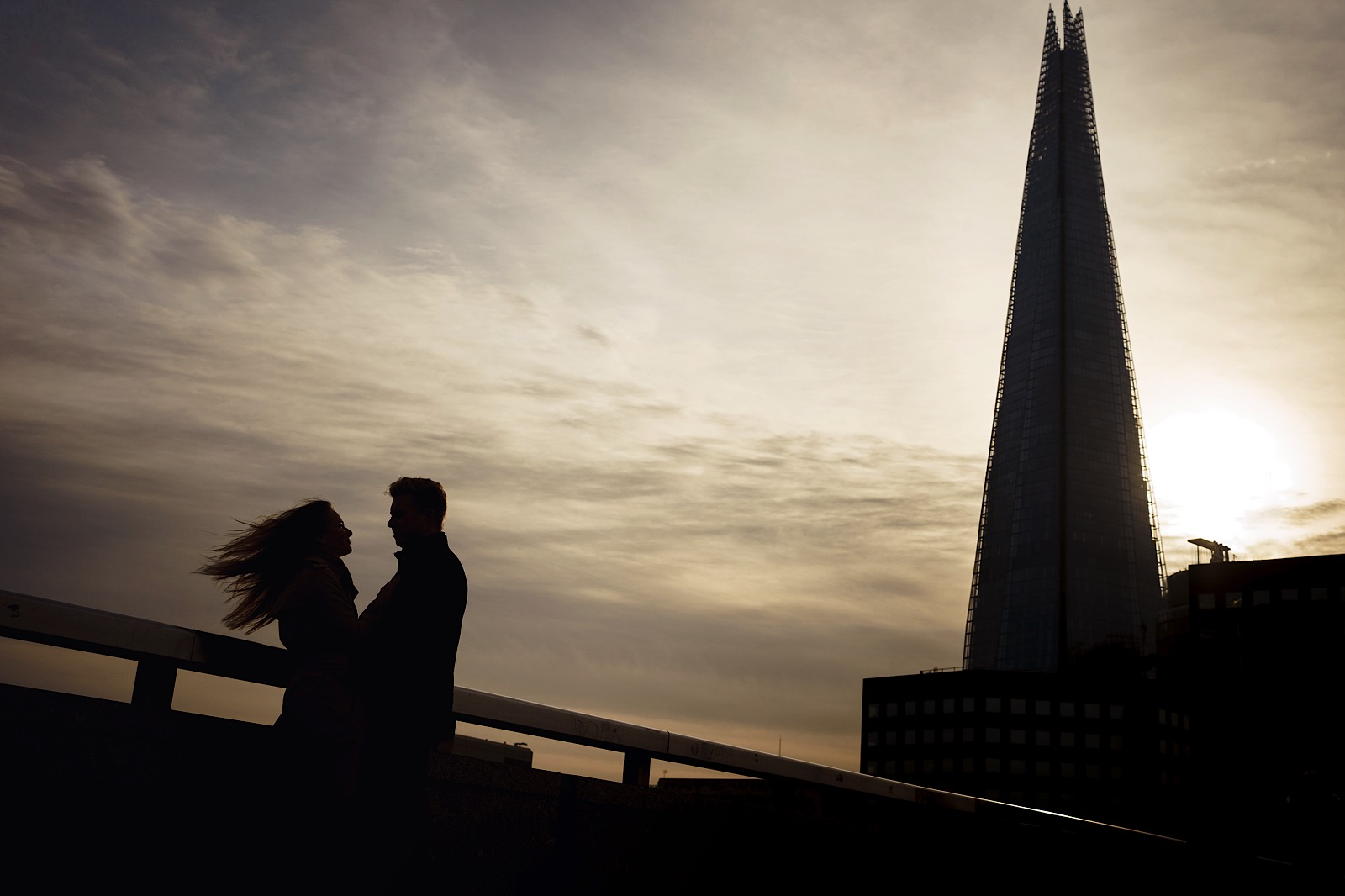 Silhouette of a couple with the SHARD in the back ground