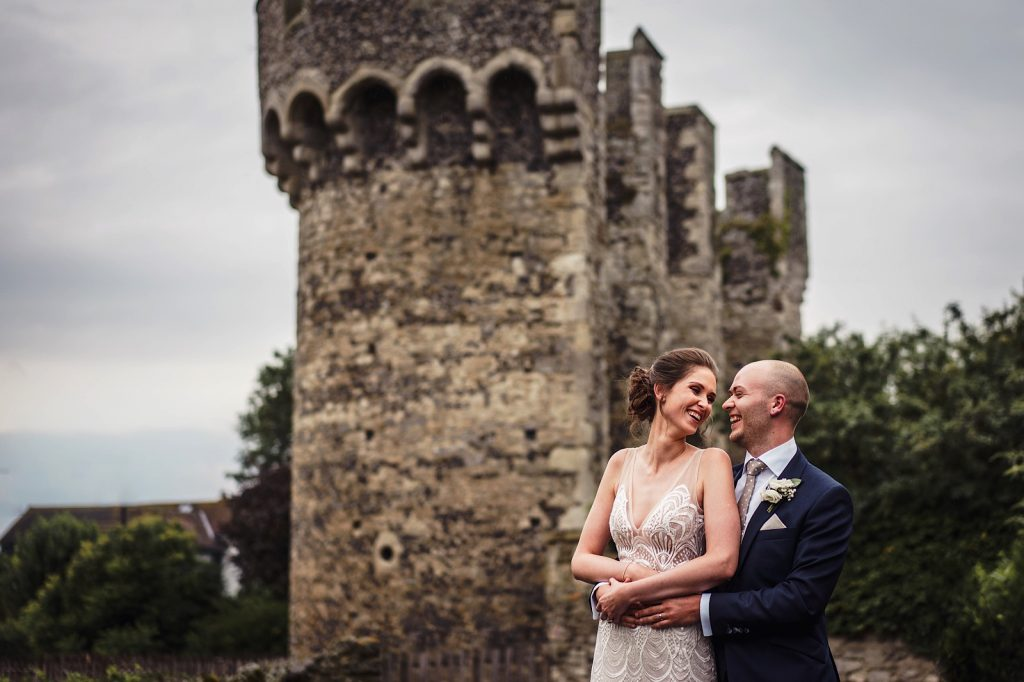 A bride and groom at cooling castle barn wedding venue