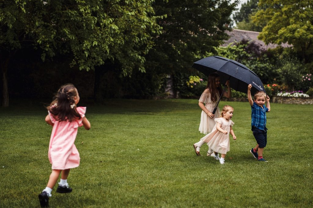 Children Playing in Garden during at wedding in kent