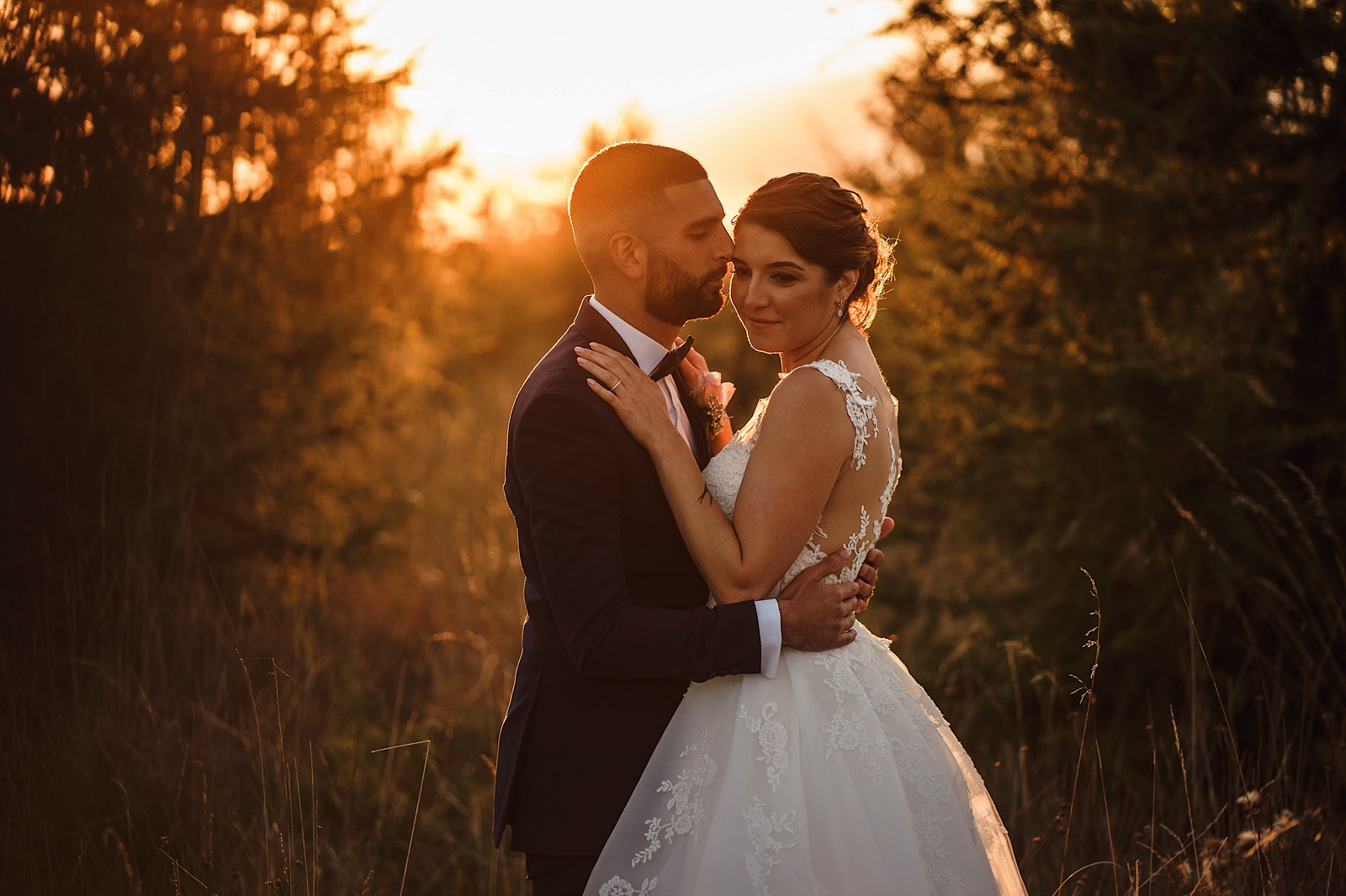 sunset portrait of bride and groom at maidens barn