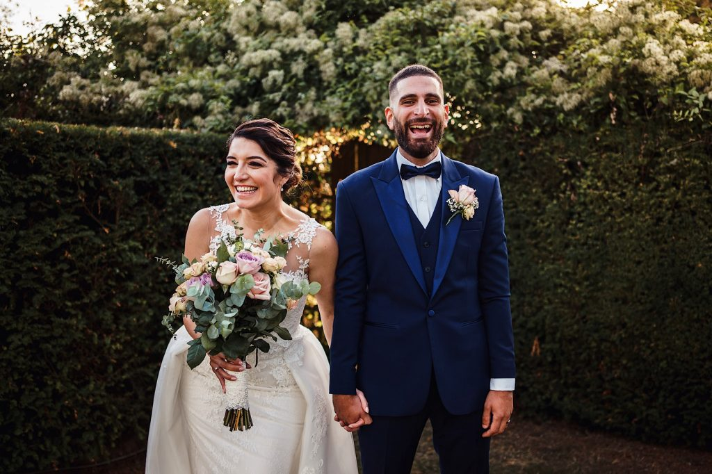 Fun portrait of a Bride and Groom Laughing