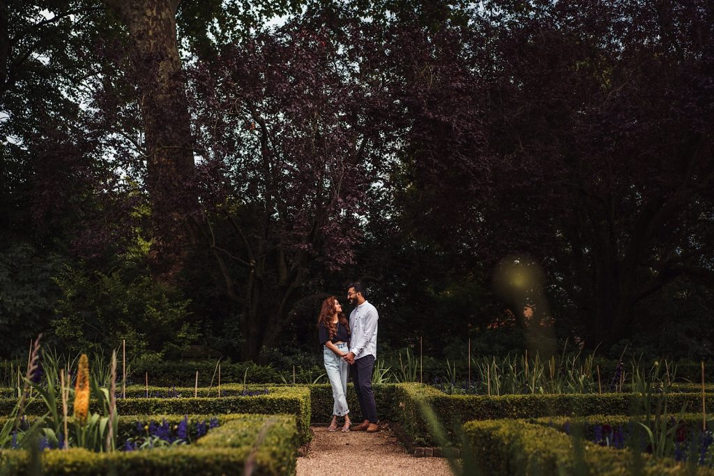 Couples standing in the gardens at Holland Park