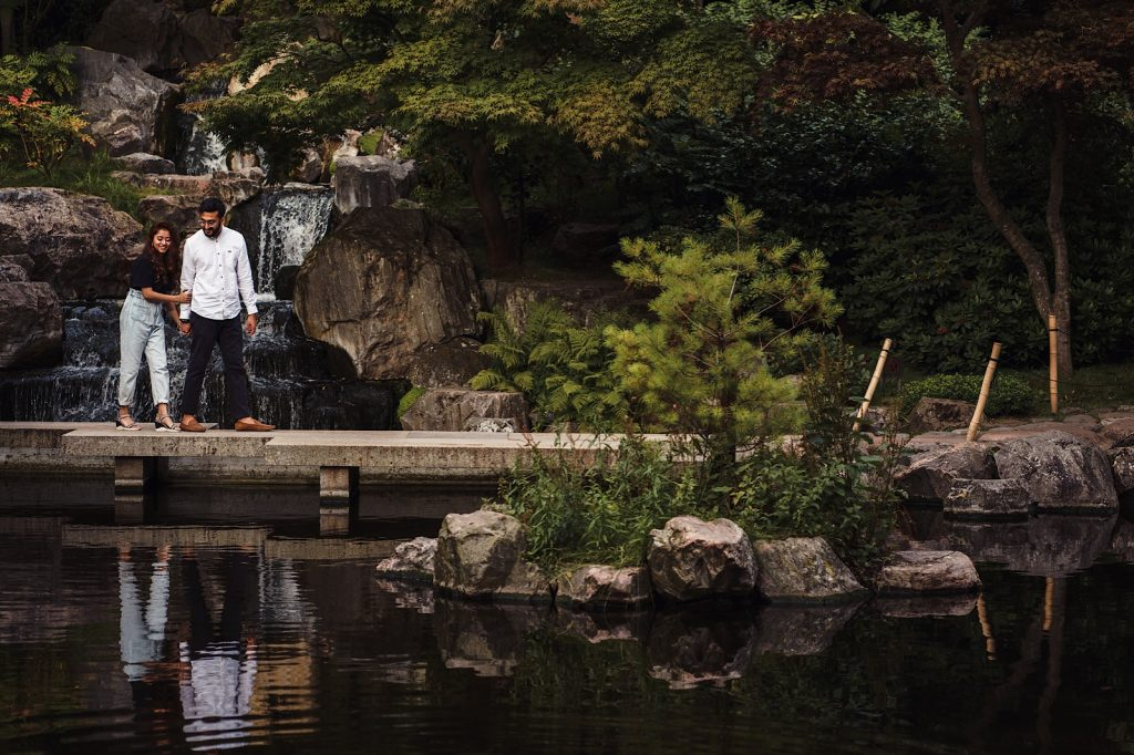 couple walking through Japanese Ornamental Kyoto Garden
