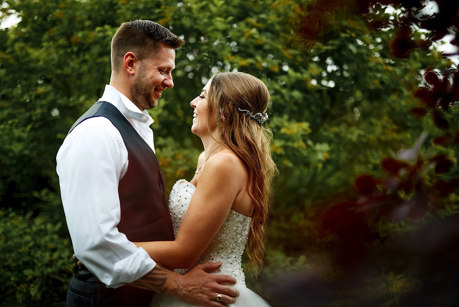 Married couple embracing in the Grounds of Wedding Venue Fennes